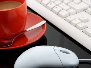 Keyboard And Mouse And A Cup Of Coffee In An Office